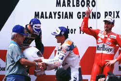 Podium: race winner Mick Doohan, second place Carlos Checa, third place Max Biaggi