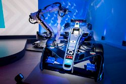 The newly-branded Formula E car is unveiled by an ABB IRB-6700 robot