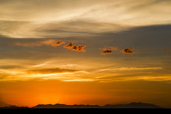 Le coucher de soleil sur Salar de Uyuni