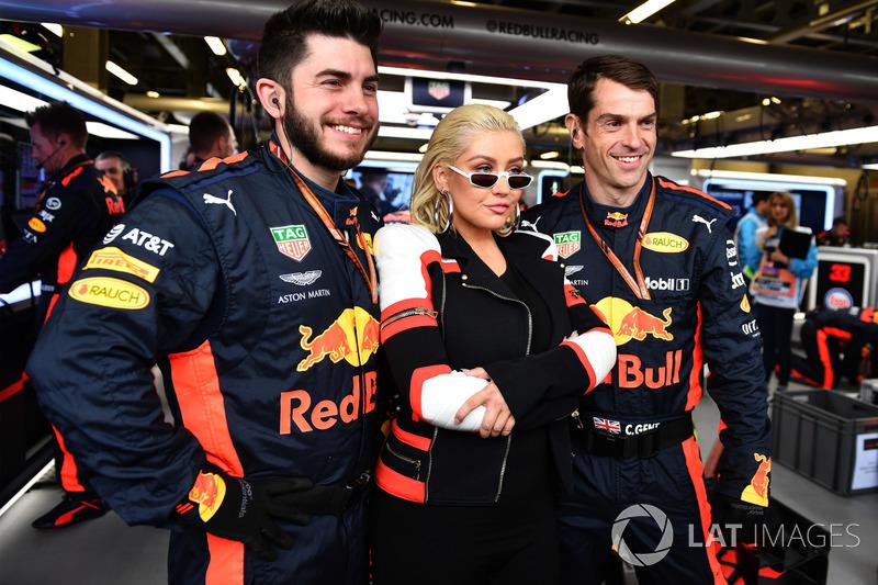Christina Aguilera, with Red Bull Racing mechanics