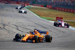 Fernando Alonso, McLaren MCL33, leads Esteban Ocon, Force India VJM11