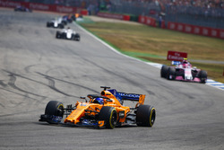 Fernando Alonso, McLaren MCL33, leads Esteban Ocon, Force India VJM11
