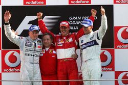 Podium: second place Kimi Raikkonen, McLaren, Jean Todt, Ferrari Sporting Director, race winner Mich