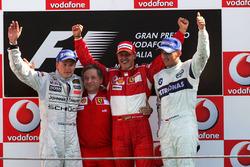 Podium: second place Kimi Raikkonen, McLaren, Jean Todt, Ferrari Sporting Director, race winner Mich