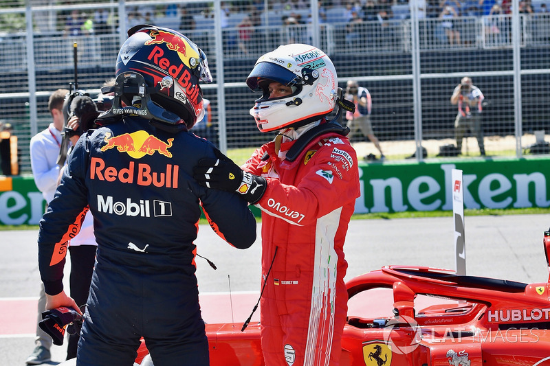 Pole sitter Sebastian Vettel, Ferrari celebrates in parc ferme with Max Verstappen, Red Bull Racing