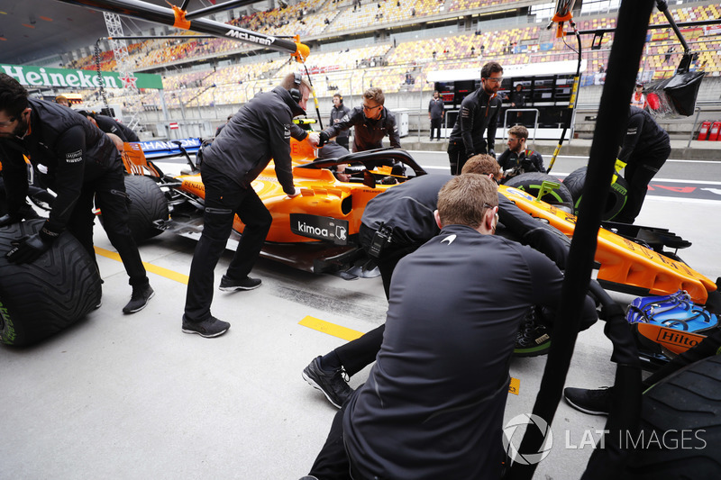 The McLaren team conduct practice pit stops