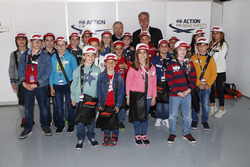 Jean Todt, President, FIA, and Chase Carey, Chairman, Formula One, with grid kids