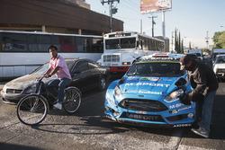 Mads Ostberg, Ola Floene, M-Sport Ford Fiesta WRC get a car wash at a stop light