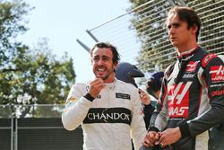Fernando Alonso, McLaren with Esteban Gutierrez, Haas F1 Team after their race stopping crash