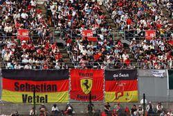 Fans in the grandstand and banners for Sebastian Vettel, Ferrari