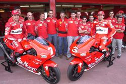 Carlos Checa, Max Biaggi with their crew members