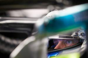 The helmet of Valtteri Bottas, Mercedes AMG F1, is reflected in his mirror
