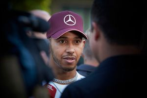 Lewis Hamilton, Mercedes AMG F1, talks to reporters