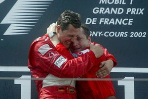 Podium: race winner Michael Schumacher, Ferrari celebrates with Jean Todt, Ferrari