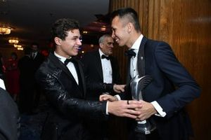 Lando Norris, McLaren, and Alexander Albon, Red Bull Racing, share a joke after the Awards ceremony