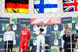 Eric Blandin, Chief Aerodynamicist, Mercedes AMG, Sebastian Vettel, Ferrari, 2nd position, Valtteri Bottas, Mercedes AMG F1, 1st position, and Lewis Hamilton, Mercedes AMG F, 3rd position, on the podium
