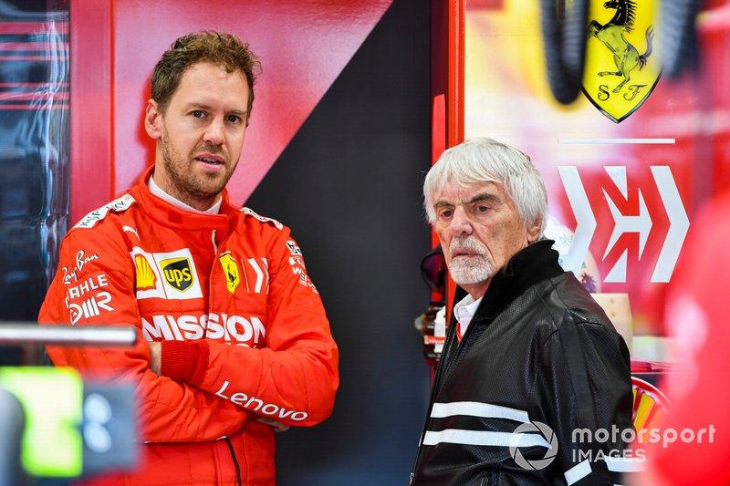 Sebastian Vettel, Ferrari e Bernie Ecclestone, Presidente emerito della Formula 1, nel garage Ferrari