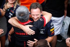 Masashi Yamamoto, General Manager, Honda Motorsport, and Christian Horner, Team Principal, Red Bull Racing, celebrate in Parc Ferme