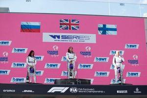 Irina Sidorkova, 2nd position, Jamie Chadwick, 1st position, and Emma Kimilainen, 3rd position, on the podium
