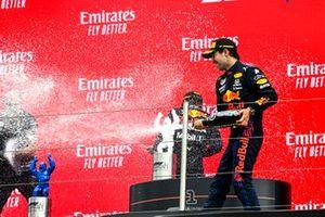 Gianpiero Lambiase, Race Engineer, Red Bull Racing, Sergio Perez, Red Bull Racinga, 3rd position, and Max Verstappen, Red Bull Racing, 1st position, spray Champagne on the podium