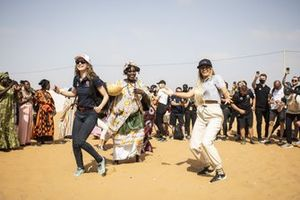Catie Munnings, Andretti United Extreme E, and Christine Giampaoli Zonca, Hispano Suiza Xite Energy Team, dance on the Eco Zone Legacy Project visit