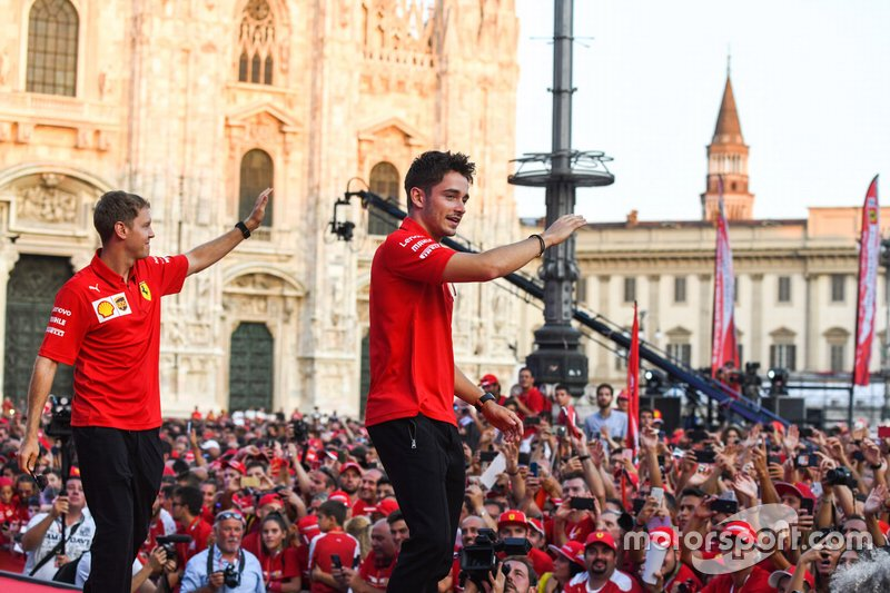 Sebastian Vettel, Ferrari and Charles Leclerc, Ferrari wave to the crowd from the stage