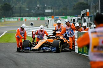 Carlos Sainz Jr., McLaren MCL34 being pushed by marshals