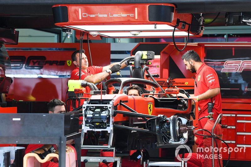 Ferrari team members at work in the garage