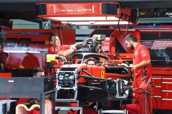 Ferrari team members at work in the garage