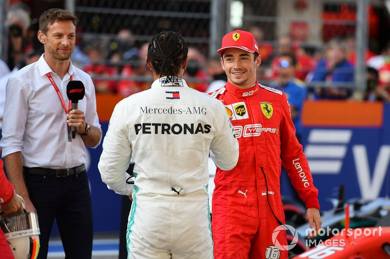 Pole winner Charles Leclerc, Ferrari, is congratulated by Lewis Hamilton, Mercedes AMG F1