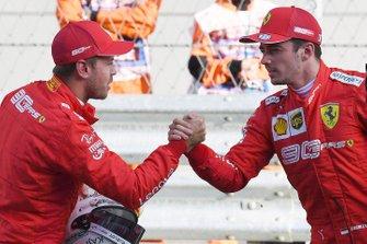 Sebastian Vettel, Ferrari, congratulates Charles Leclerc, Ferrari, on securing pole