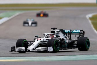 Lewis Hamilton, Mercedes AMG F1 W10 leads Valtteri Bottas, Mercedes AMG W10 and Max Verstappen, Red Bull Racing RB15