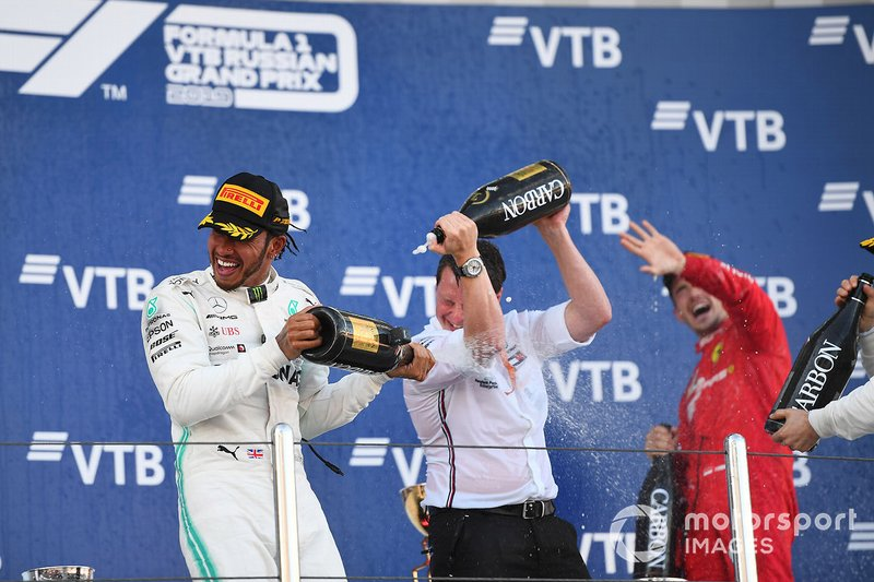 Lewis Hamilton, Mercedes AMG F1, 1st position, Fred Judd, Chief Engineer Trackside, Mercedes AMG F1, and Charles Leclerc, Ferrari, 3rd position, celebrate on the podium