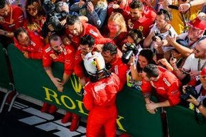 Sebastian Vettel, Ferrari, 3rd position, celebrates with his team in Parc Ferme