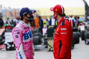 Sergio Perez, Racing Point, 2nd position, and Sebastian Vettel, Ferrari, 3rd position, talk in Parc Ferme