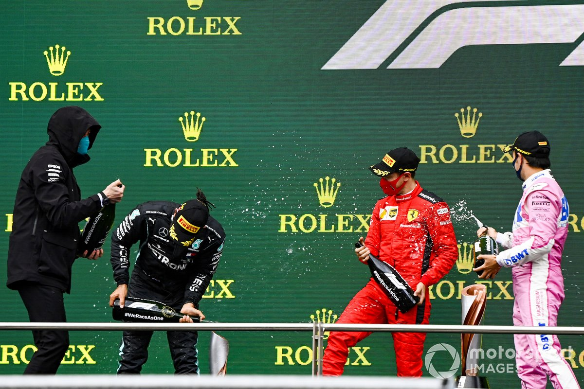 Toto Wolff, Executive Director (Business), Mercedes AMG, Lewis Hamilton, Mercedes-AMG F1, 1st position, Sebastian Vettel, Ferrari, 3rd position, and Sergio Perez, Racing Point, 2nd position, celebrate on the podium