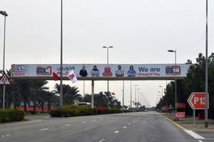 Signage paying tribute to Bahrain's health worker heroes on roads into the circuit