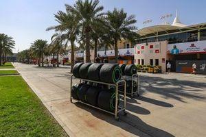 Pirelli tyres are wheeled through the paddock