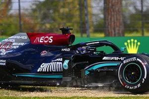 Lewis Hamilton, Mercedes W12, heads through the gravel