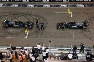 Lewis Hamilton, Mercedes-AMG F1, 3rd position, and Valtteri Bottas, Mercedes-AMG F1, 2nd position, celebrate on the grid after performing celebratory donuts