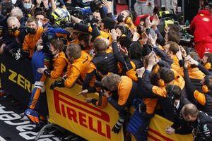 Members of the McLaren team congratulate Lando Norris, McLaren, 3rd position, in Parc Ferme