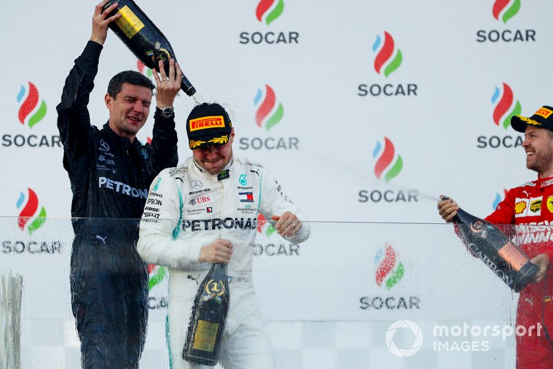 Race Winner Valtteri Bottas, Mercedes AMG F1 and Sebastian Vettel, Ferrari celebrate on the podium with the champagne