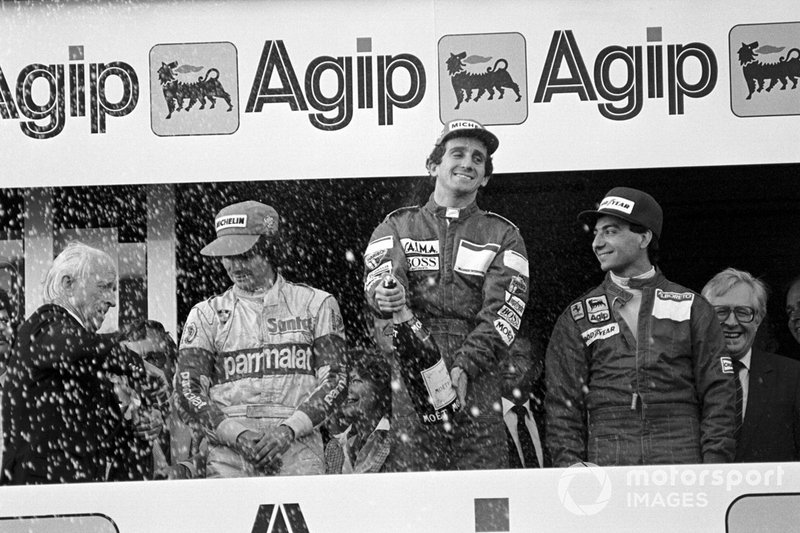 The podium: Nelson Piquet, Brabham third; Alain Prost, McLaren winner; Michele Alboreto, Ferrari second