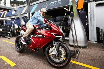 Lewis Hamilton, Mercedes AMG F1 arrives on his motorbike