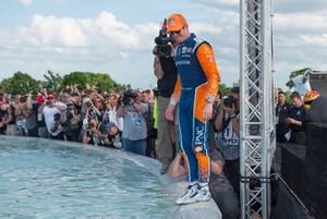 Scott Dixon, Chip Ganassi Racing Honda, prepares to jump into Scott Fountain after race win.
