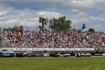 Josef Newgarden, Team Penske Chevrolet leads through turn 1 at the start