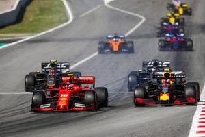 Charles Leclerc, Ferrari SF90 and Pierre Gasly, Red Bull Racing RB15 battle after the Safety Car