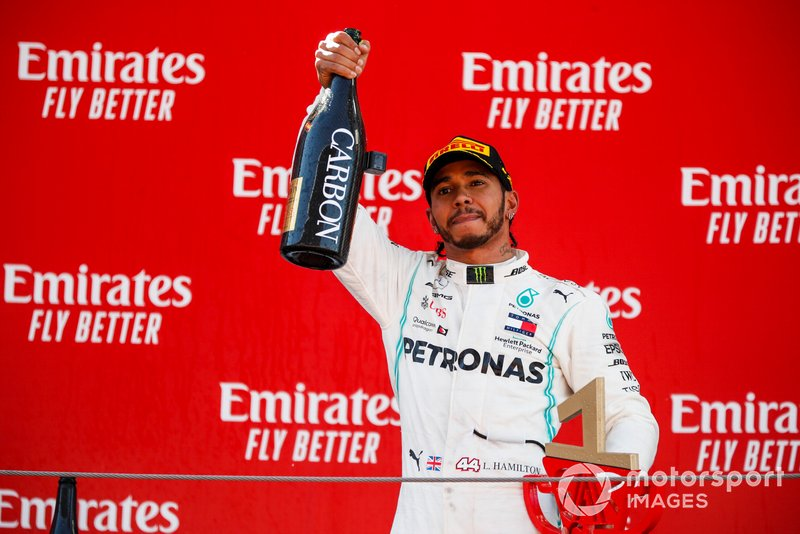 Lewis Hamilton, Mercedes AMG F1, 1st position, with Champagne on the podium