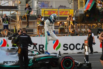Pole man Valtteri Bottas, Mercedes AMG F1, celebrates on his car after Qualifying