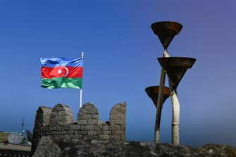 The Azerbaijan flag flies from ramparts
